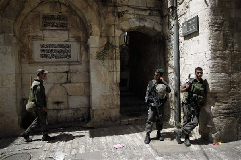 Israeli border police stand guard inside Jerusalem's Old City after Friday prayers, Friday, June 10, 2011. Israeli policemen entered a sensitive Jerusalem holy site known to Jews as the Temple Mount and to Muslims as the Noble Sanctuary on Friday and used stun grenades to disperse dozens of Palestinian protesters who were hurling stones at security personnel, police said. (AP Photo/Tara Todras-Whitehill)