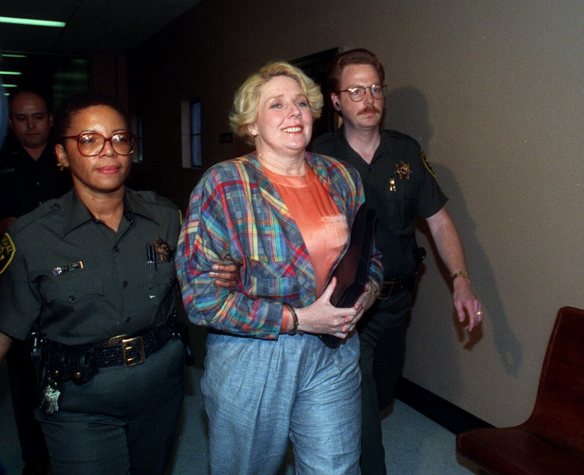 """Dec. 10, 1991 -- Elisabeth """"Betty"""" Broderick being led by marshals through the hallways of the downtown San Diego County Courthouse on her way to a holding cell after her verdict came in for the murder of her ex-husband Dan and his new wife Linda. Union-Tribune file photo by Don Kohlbauer)"""