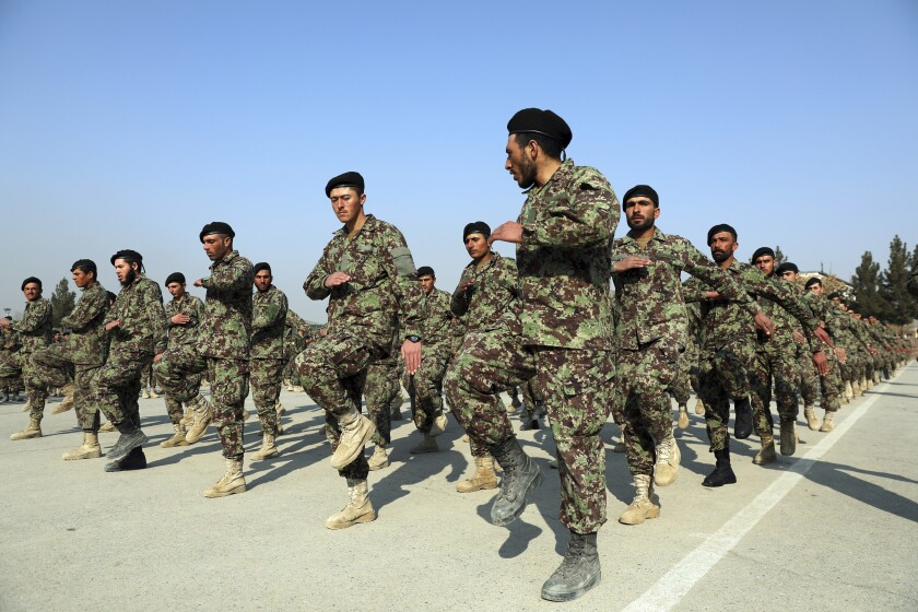 New Afghan army troops march during their graduation ceremony at the Afghan Military Academy in Kabul.