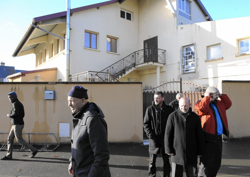 Worshipers leave a mosque in Le Mans, France, on Jan. 8. One shot was fired and three blank grenades were thrown outside the mosque overnight. No one was injured.