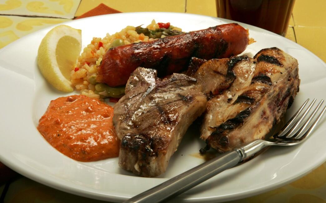 Grilled rabbit, lamb and chorizo with romesco sauce