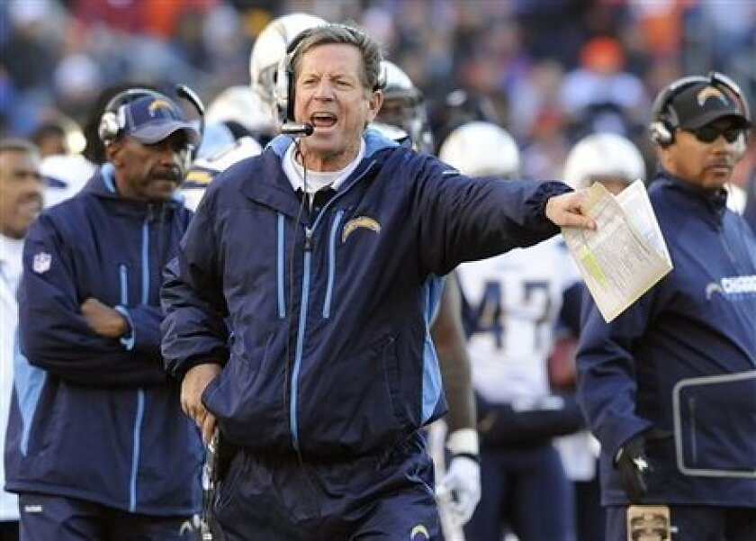 San Diego Chargers head coach Norv Turner argues a call in the second quarter of an NFL football game against the Denver Broncos, Sunday, Jan. 2, 2011, in Denver.
