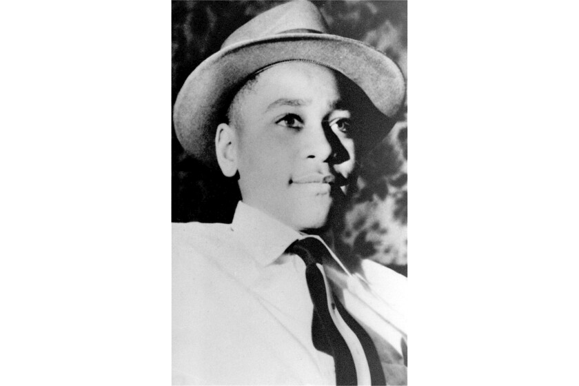 FILE - This undated file photo shows Emmett Till, a 14-year-old black Chicago boy, whose body was found in the Tallahatchie River near the Delta community of Money, Miss., Aug. 31, 1955. The Greenwood Commonwealth reports that a new historical marker was dedicated Saturday, Oct. 19, 2019, with members of Till's family in attendance. This is the fourth historical marker at the site. The first was thrown in the river. The second and third signs were shot at and became riddled with bullet holes. (AP Photo, File)