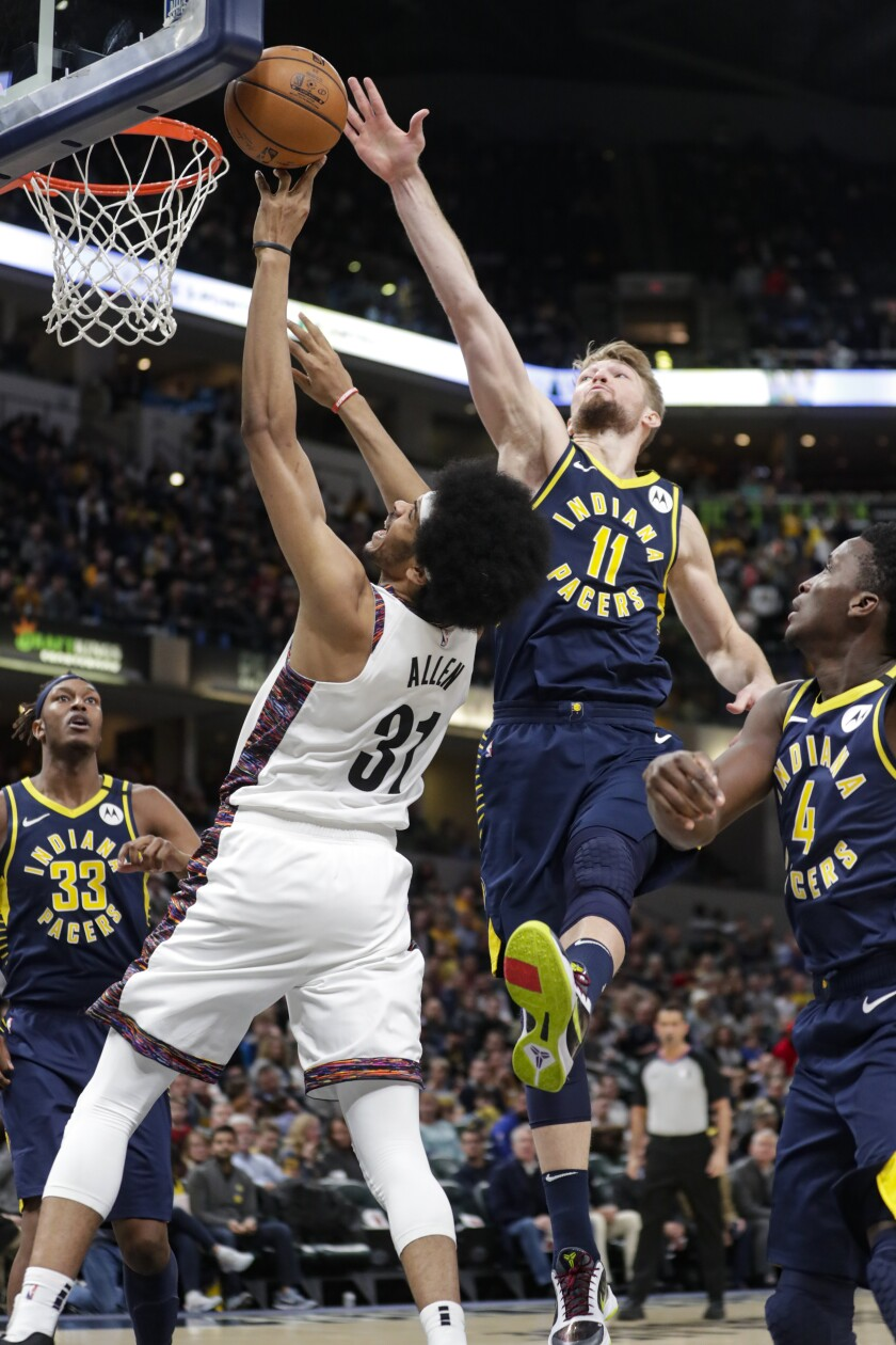 Indiana Pacers forward Domantas Sabonis (11) blocks the shot of Brooklyn Nets center Jarrett Allen (31) during the second half of an NBA basketball game in Indianapolis, Monday, Feb. 10, 2020. (AP Photo/Michael Conroy)