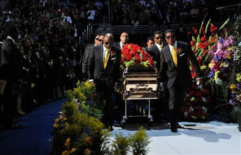 In this image released by the Jackson family, pallbearers carry a casket holding Michael Jackson's body into a memorial for the pop star at the Staples Center on Tuesday, July 7, 2009 in Los Angeles. (AP Photo/courtesy of The Jackson Family, Kevin Mazur)