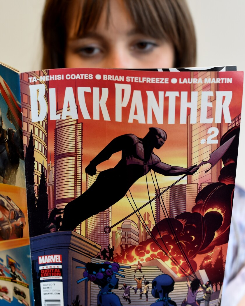"""A woman reads the comic """"Black Panther"""""""