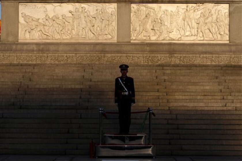 In this photo taken on March 24, 2009, a paramilitary soldier stands guard in Tiananmen Square in  Beijing. The Chinese government is heavily invested in suppressing the memory of the 1989 Tiananmen Square democracy movement and its violent end. Two decades on the authoritarian government has large