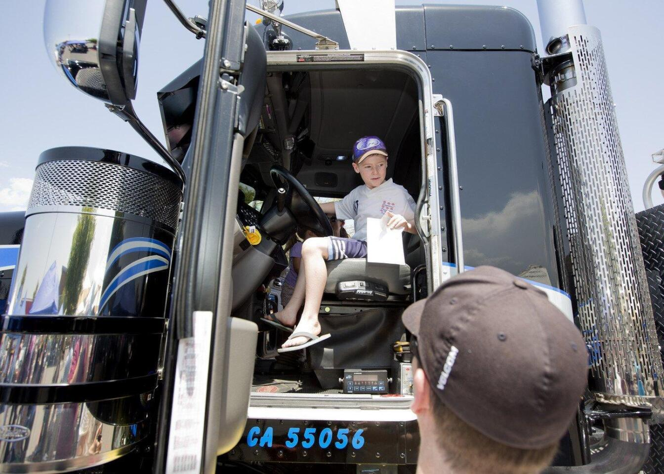 Ethan McCall sits in a huge tow truck