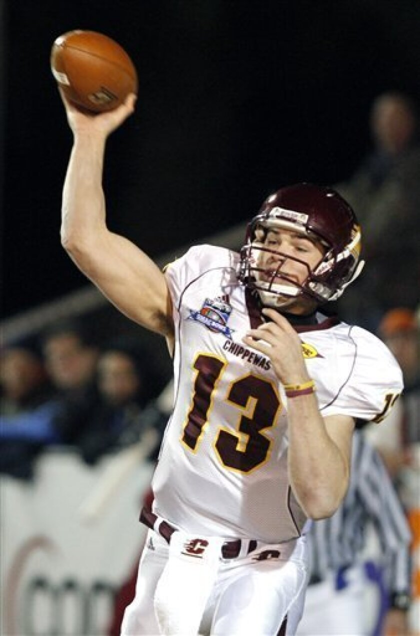 Central Michigan quarterback Dan LeFevour (13) throws a second-quarter pass against Troy during their NCAA college football GMAC Bowl game, Wednesday, Jan. 6, 2010, in Mobile, Ala. (AP Photo/Rogelio V. Solis)
