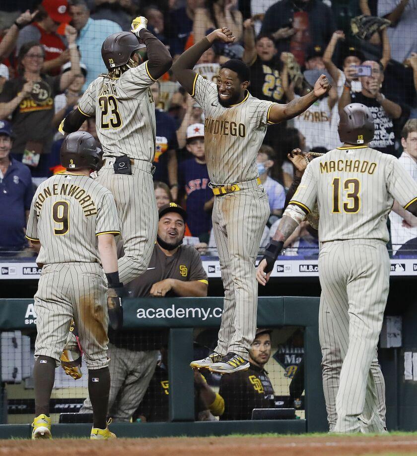 The Padres celebrate Fernando Tatis Jr.'s three-run homer