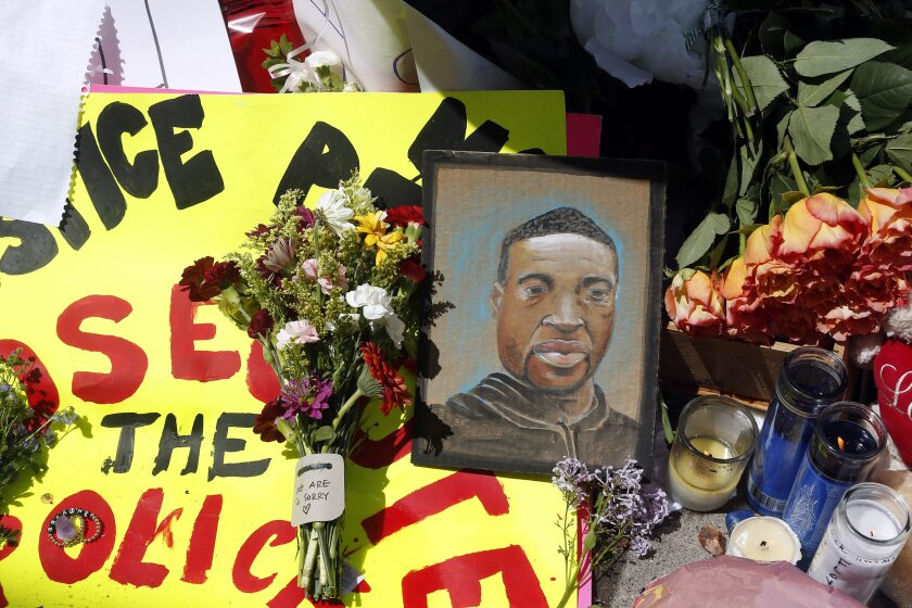 A portrait of George Floyd is part of a makeshift memorial for him on May 27 near the site of his arrest in Minneapolis.