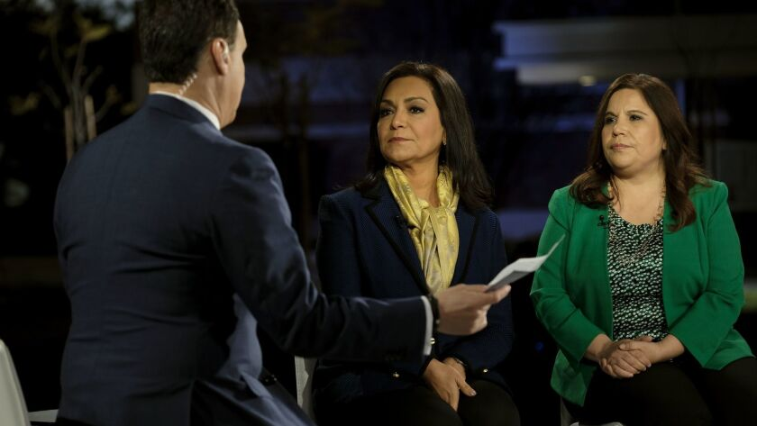 """PresenterJosé Díaz-Balar, lawyer Alma Rosa Nieto, center and CHIRLA Executive Director Angélica Salas on the Telemundo set at East Los Angeles College for the """"Know Your Rights"""" broadcast."""