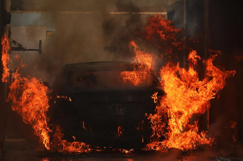A car is set ablaze during fighting between Islamist militias and forces loyal to a former general, Khalifa Haftar, in the Libyan city of Benghazi.
