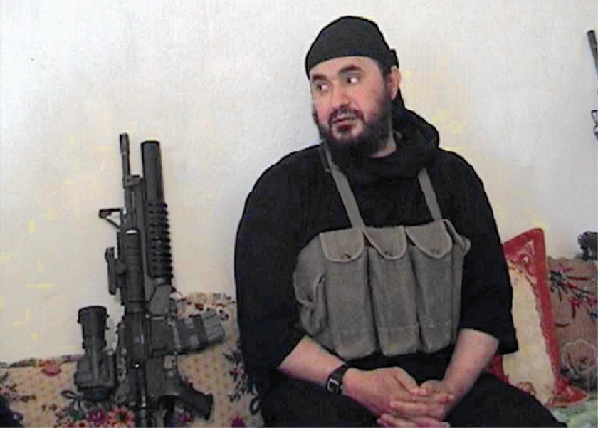 Abu Musab Zarqawi, seen in a photo from the Department of Defense, was killed in 2006. He charted a more ambitious course than fellow terrorist Osama bin Laden.