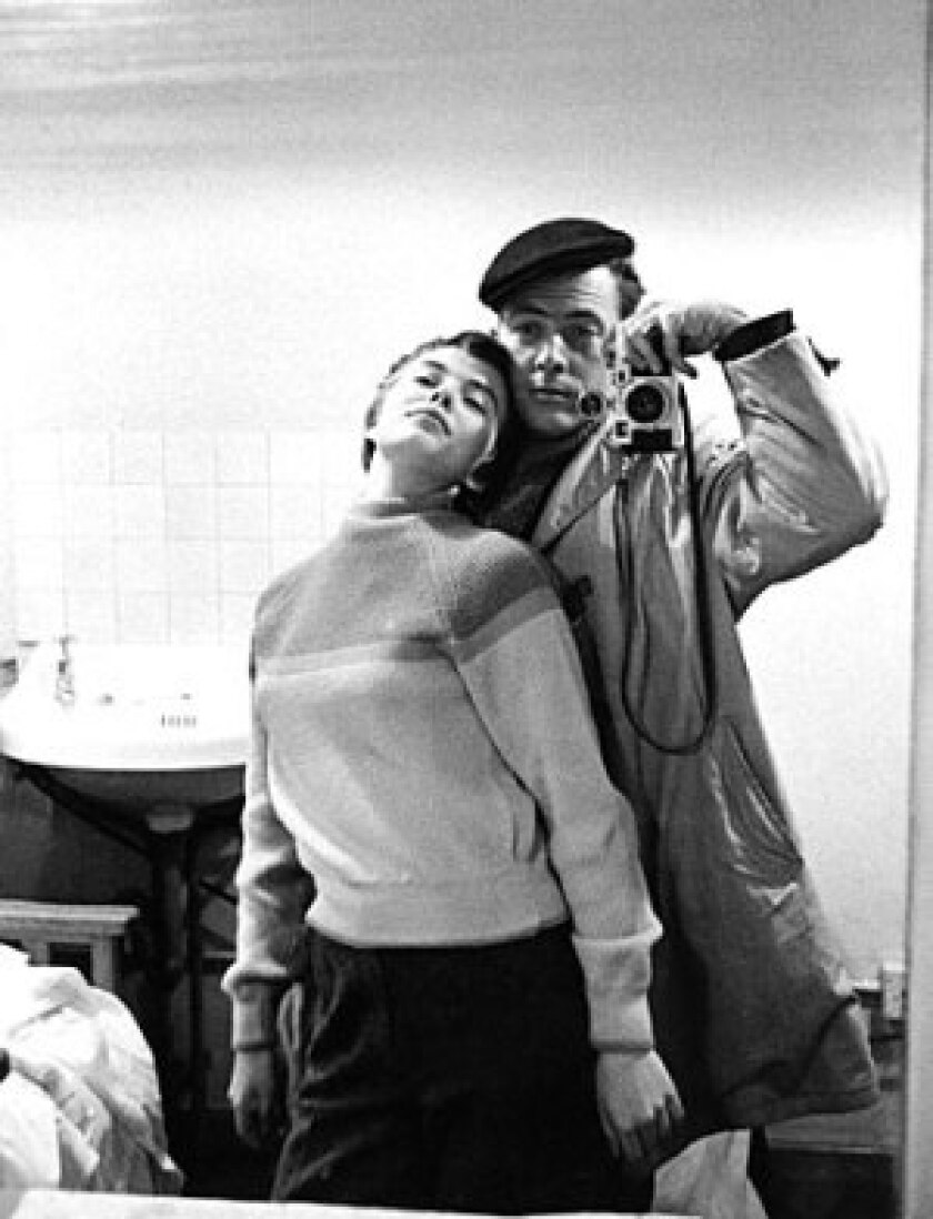 """Photographer Bob Willoughby and Jean Seberg during the making of """"Saint Joan,"""" 1957."""
