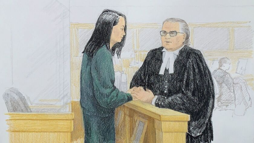 In this sketch by Jane Wolsak, Meng Wanzhou, left, Huawei's chief financial officer, speaks with lawyer David Martin in a courtroom in Vancouver, Canada, on Monday.