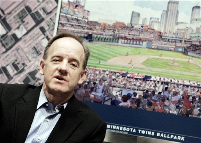 FILE - In this Feb. 29, 2008 file photo, Jim Pohlad meets with reporters Friday, Feb. 29, 2008, in Minneapolis. Pohlad says he's staying out of contract negotiations with catcher Joe Mauer. Pohlad declined Monday, Feb. 8, 2010, to discuss specifics or confirm the team is talking about a long-term extension for the American League MVP. Pohlad said the Twins simply want to have Mauer in uniform. (AP Photo/Jim Mone)