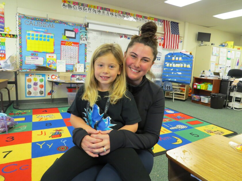 Katelynn Hardee, a kindergartnener at Breeze Hill Elementary School in Vista, with her mother, Karina. Katelynn raised funds to pay off negative lunch balances for classmates