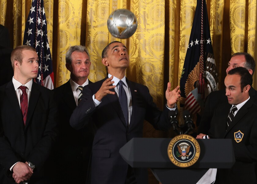 U.S. President Barack Obama bounces a soccer ball off his head when both the Kings and Galaxy visited the White House in 2013 following championships.