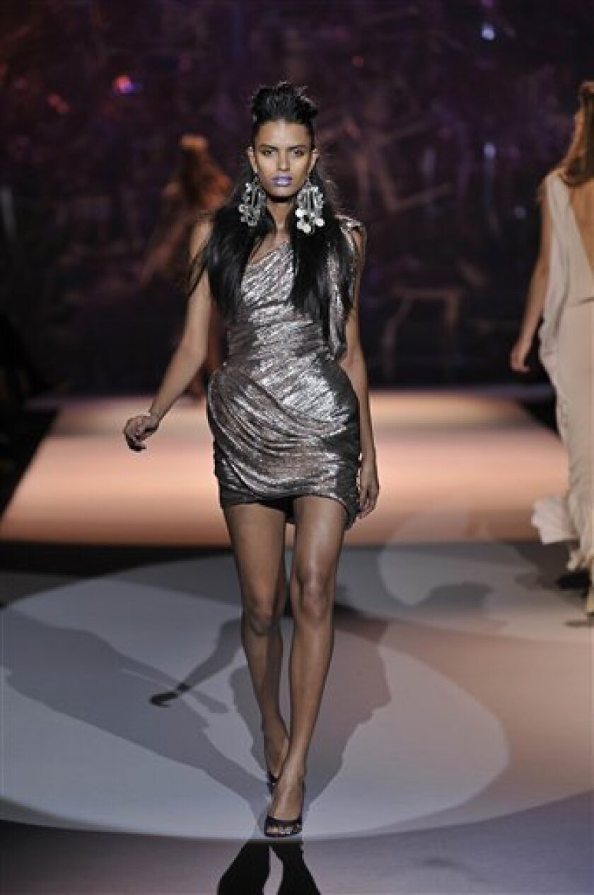 In this image provided by fashion photographers Dan & Corina Lecca, a model for Zac Posen walks the runway during the designer's Spring-Summer 2009 fashion collection presentation Sept. 11, 2008, during Fashion Week in New York. (AP Photo/Dan & Corina Lecca)