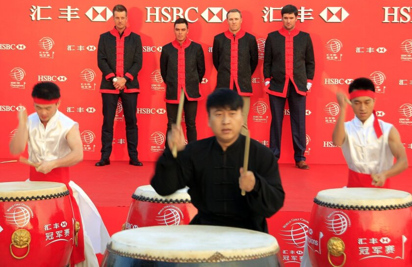 Back from left to right, golf players Henrik Stenson, Rickie Fowler, Jordan Spieth and Bubba Watson, watch Chinese drummer's perform during the HSBC Champions golf tournament photocall in Shanghai, China Tuesday, Nov. 3, 2015. (AP Photo)