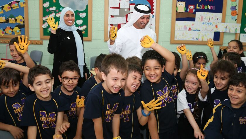 Roumi meets with schoolchildren to promote happiness and a positive attitude.