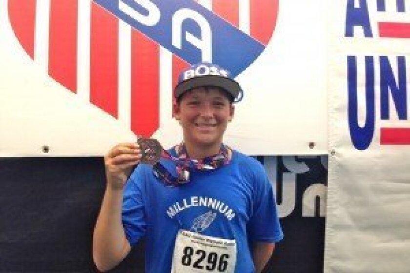 Chris White holds his bronze medal.