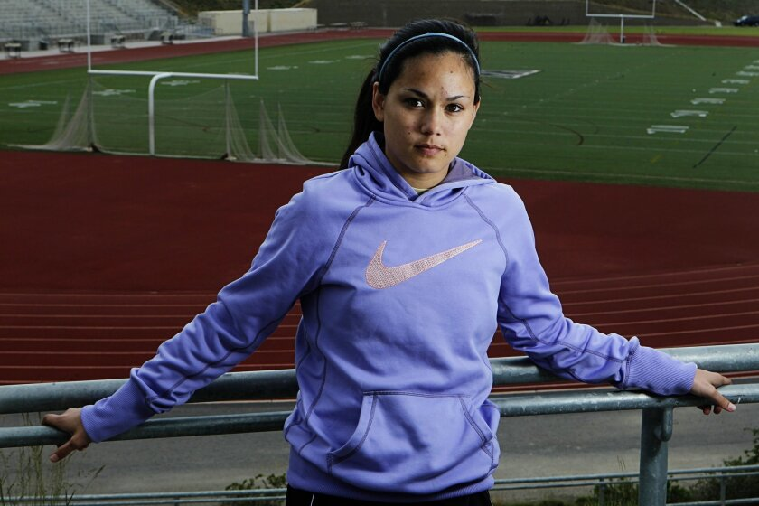 Danielle Meriwether stands in the stadium at Westview High School on Wednesday in San Diego, California. Merriwether played soccer for years, but from age 13 through 16 she suffered six concussions and had to quit the game. She's now trying to play again, at Miramar College.