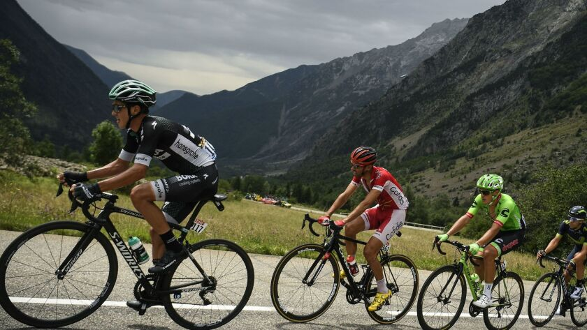 Poland's Pawel Poljanski, left, with Spain's Daniel Navarro and Switzerland's Michael Albasini during the 17th stage of the Tour de France on July 19.