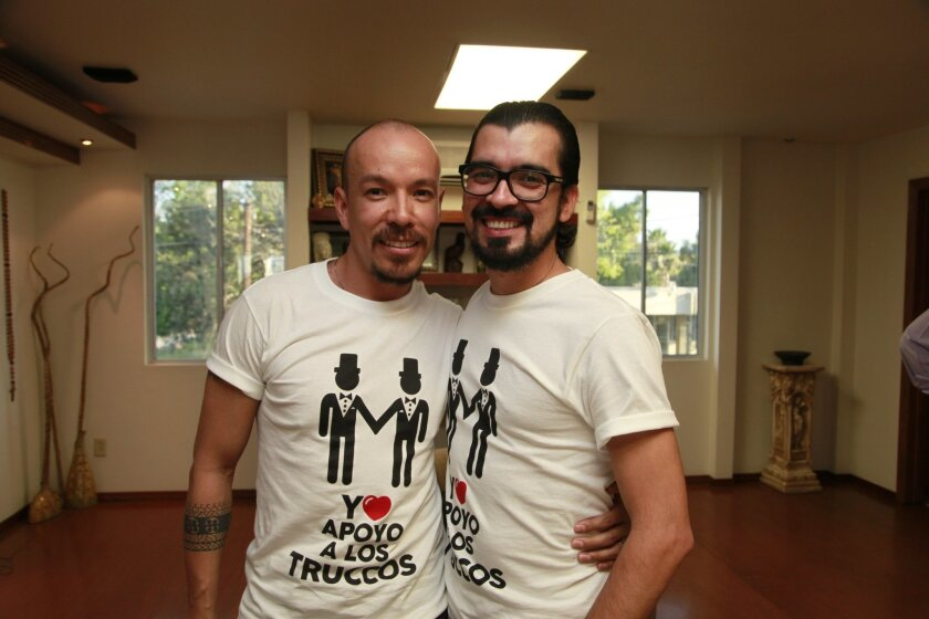 Víctor Manuel Aguirre, left and Fernando UrÍas Amparo celebrate Wednesday's ruling by the Mexican Supreme Court that allows them to marry in Baja California.