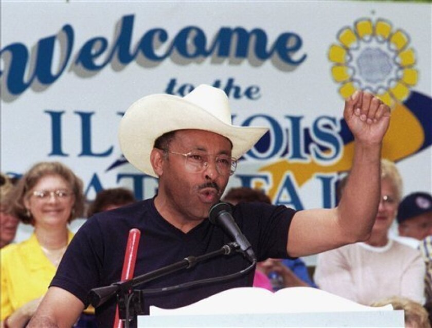 In this Aug. 14, 1997 file photo, Democratic gubernatorial candidate Roland Burris addresses a crowd at a rally during Democrat Day at the Illinois State Fair in Springfield. The 71-year-old Burris, not shy about limelight and touting his accomplishments, edged closer, Thursday, Jan. 8, 2009, to g