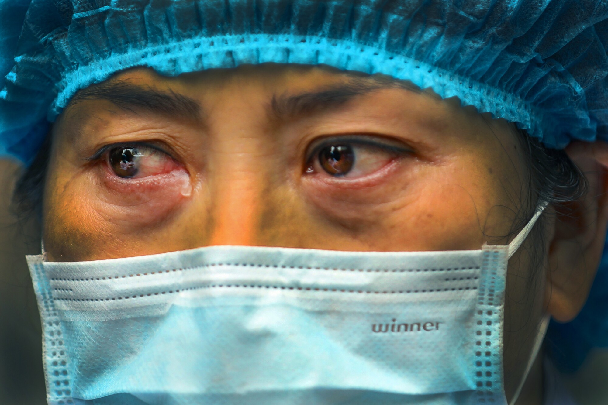 CHINA: A nurse sheds a tear while discussing the situation at Jinyintan Hospital in Wuhan in central China's Hubei province, where the coronavirus outbreak began, on Feb. 13.