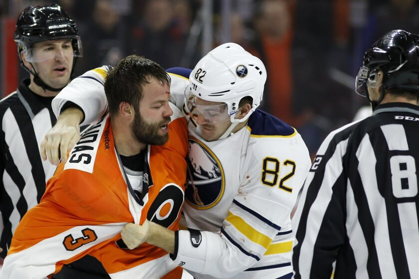 Philadelphia Flyers' Radko Gudas (3) and Buffalo Sabres' Marcus Foligno (82) fight during the second period of an NHL hockey game, Thursday, Feb. 11, 2016, in Philadelphia. (AP Photo/Matt Slocum)