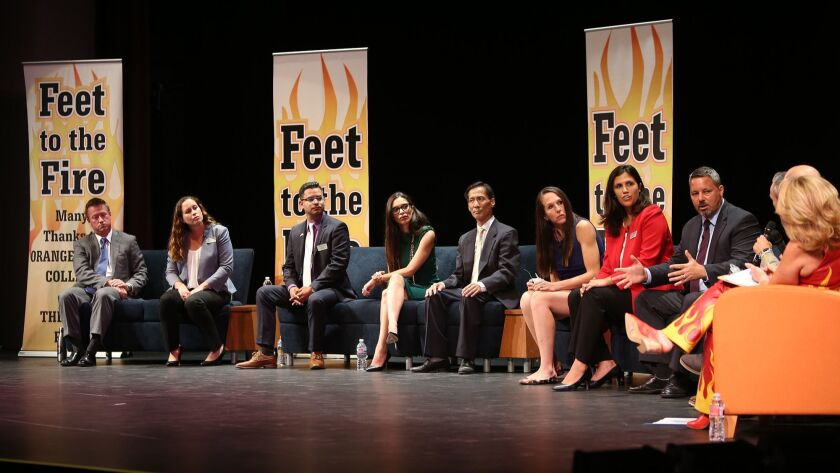 Costa Mesa city council candidates answer questions about the homeless issue during the Feet to the