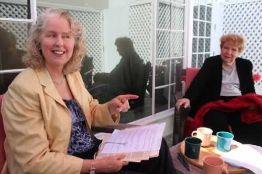 Christina Welton and Virginia DeGeneres talk about their faith in Christian Science at the church's reading room on Girard Avenue.
