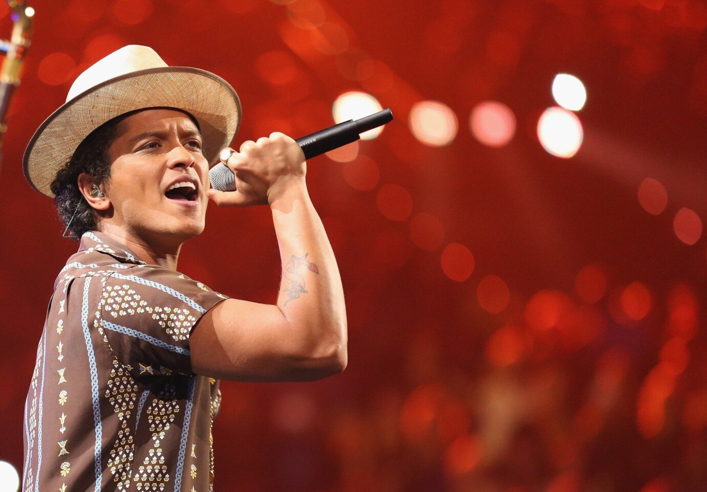 Singer Bruno Mars, shown performing during the iHeartRadio Music Festival at the MGM Grand in Las Vegas in September, is among the 2014 Headwear Hall of Fame inductees.