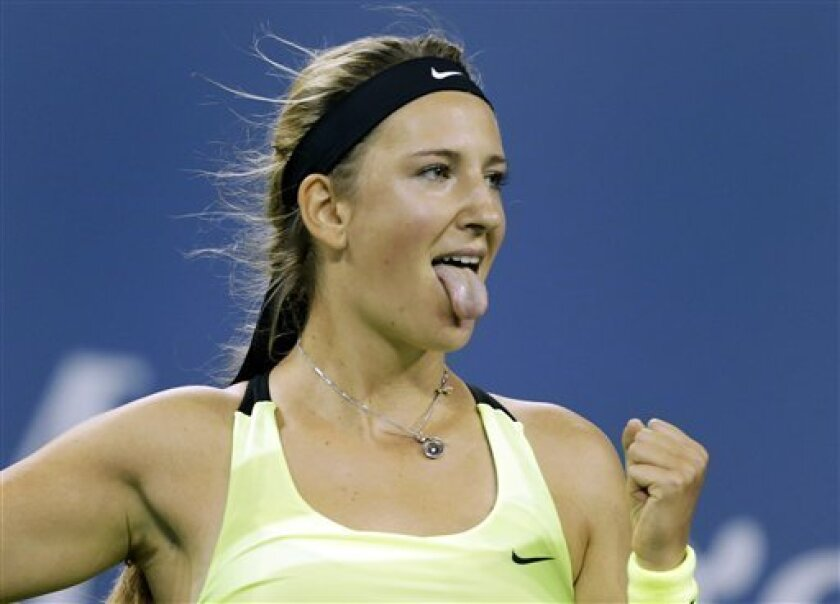 Victoria Azarenka, of Belarus, celebrates her 6-0, 6-1, win over Zheng Jie, of China, in the third round of play at the U.S. Open tennis tournament, Friday, Aug. 31, 2012 in New York. (AP Photo/Charles Krupa)
