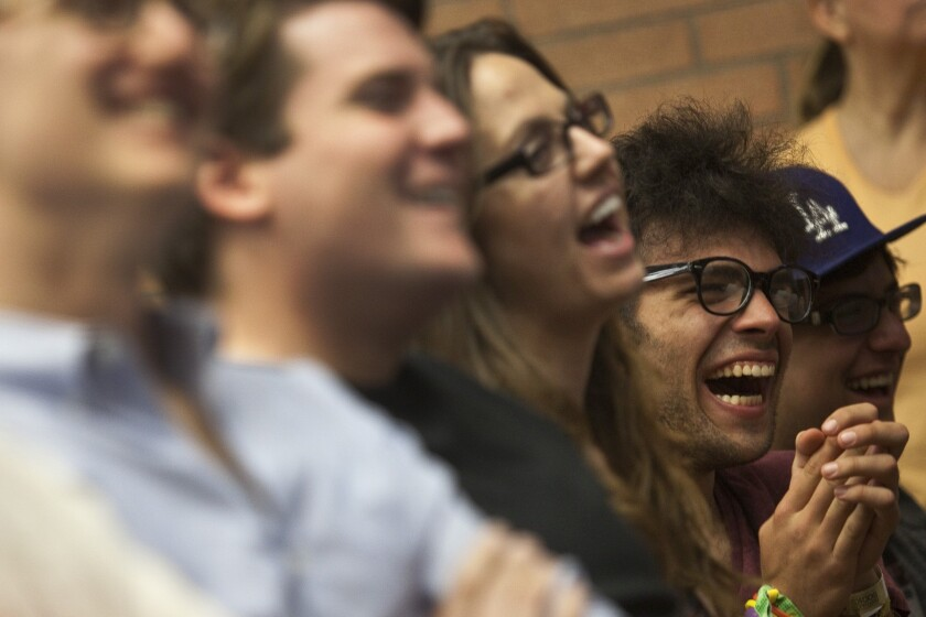 Audience members laugh during a panel of comedians at the Los Angeles Times Festival of Books in 2013.