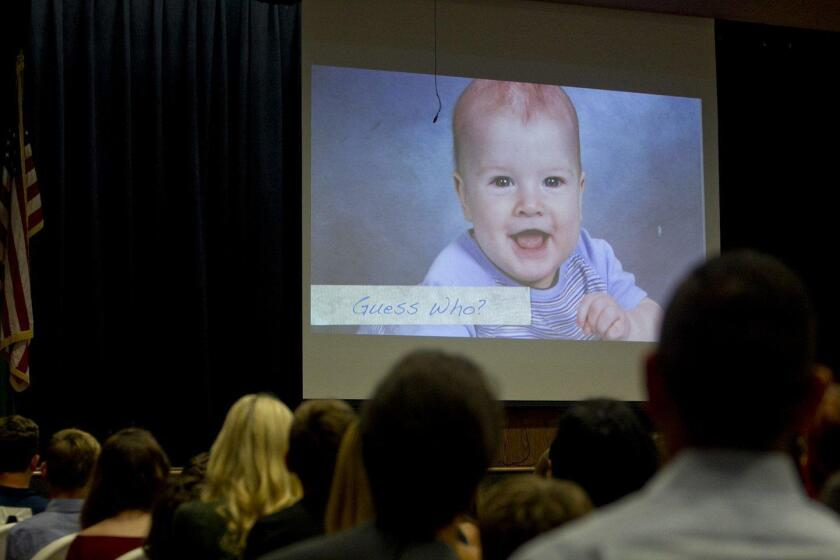The 6th grade Promotion program included a slide show of the class's baby pictures
