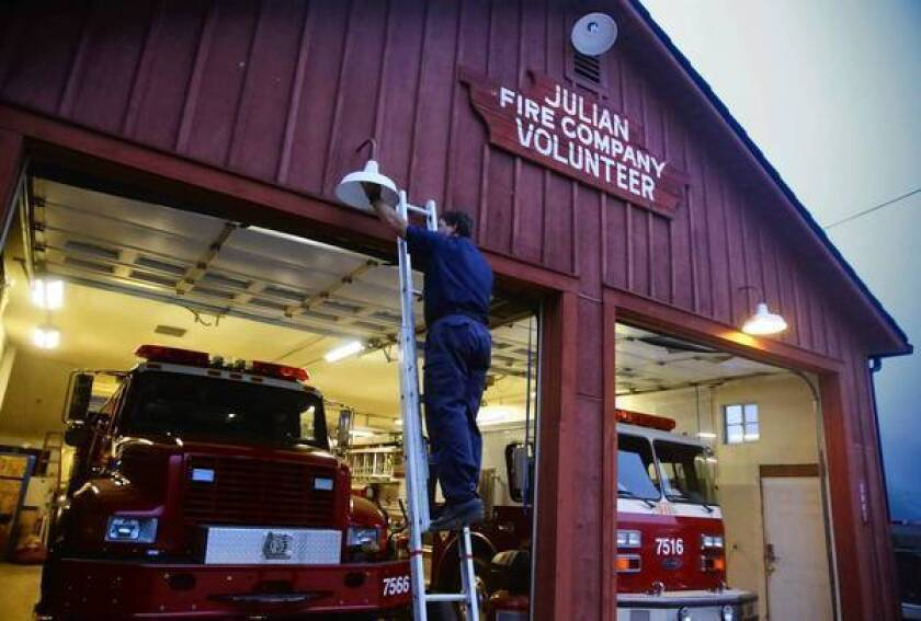 Engineer Brian Crouch checks a lightbulb at the Julian Volunteer Fire Company in the northern San Diego County mountain town. The town recently declined an offer for protection from the county Fire Authority.