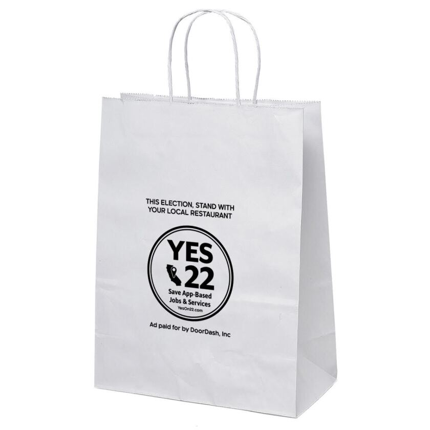 "A delivery bag is emblazoned with ""Yes 22. Save App-Based Jobs & Services."" Below, it says ""Ad paid for by DoorDash."""