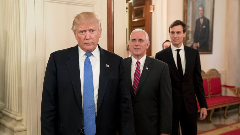 Donald Trump, Vice President Mike Pence, and Senior Advisor to President Trump Jared Kushner enter the State Dining Room, in front of an oil portrait of former U.S. President Ronald Reagan.