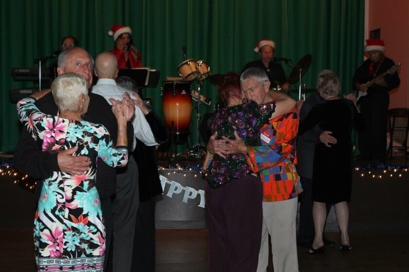 Ira and Lottie Goodman dancing, with Joan and Roland Bleu in a similar embrace