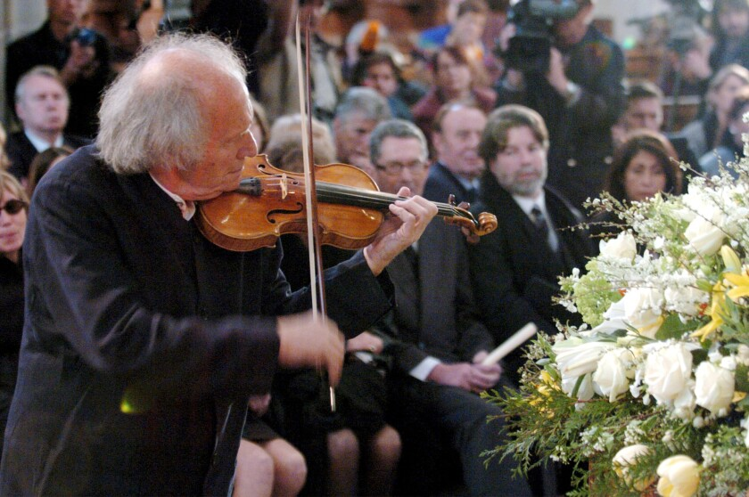 Israeli violinist Ivry Gitlis plays at the funeral of Peter Ustinov in 2004.