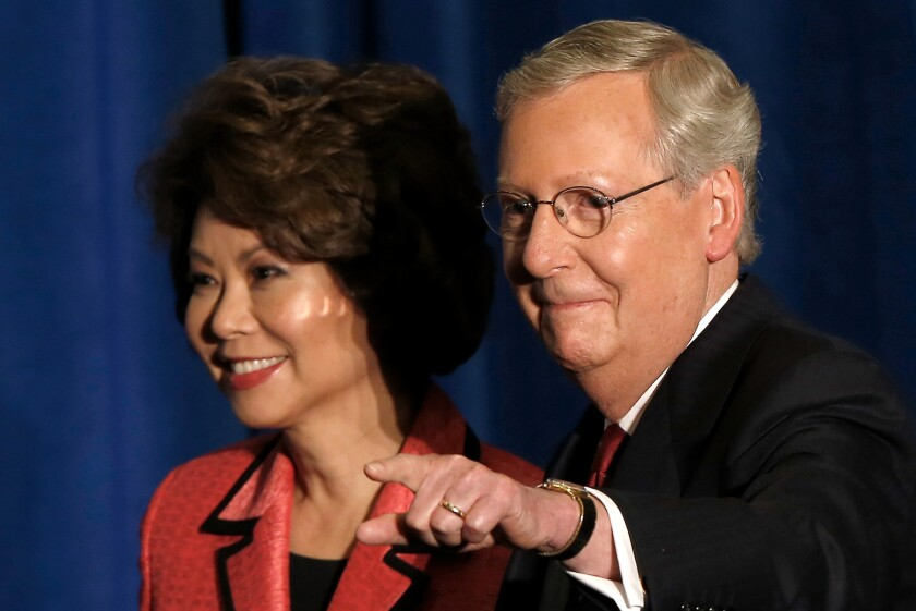 Sen. Mitch McConnell (R-Ky.) and his wife Elaine Chao arrive for a victory celebration following the early results of the state Republican primary in Louisville, Kentucky.