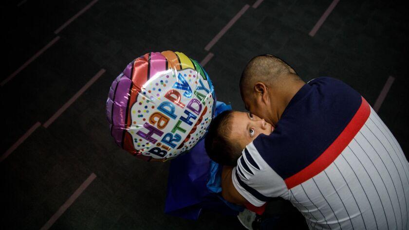 LOS ANGELES, CALIF. -- SATURDAY, JULY 14, 2018: Guatemalan asylum seeker Hermelindo Che Coc embraces