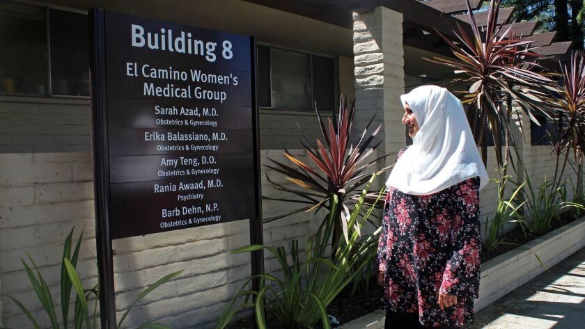 Dr. Sarah Azad stands outside the independent OB-GYN practice she runs in Mountain View, Calif., in 2017.