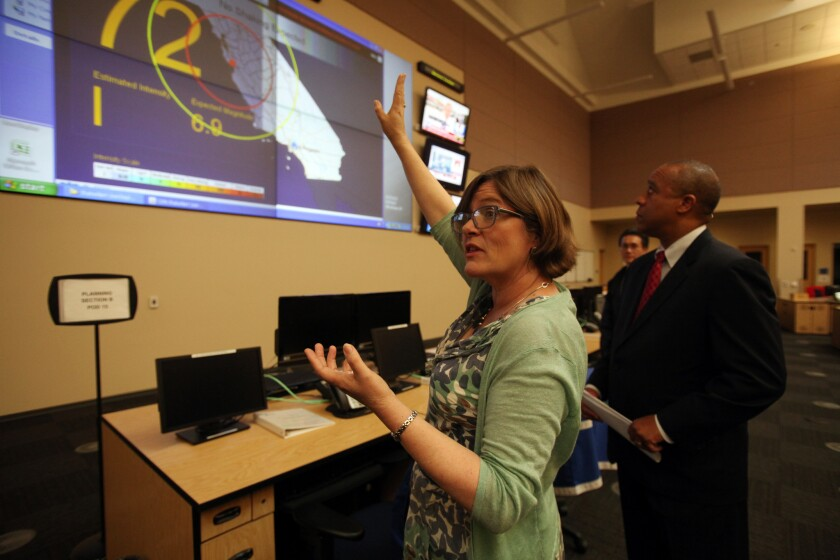 Lucy Jones of the U.S. Geological Survey and James G. Featherstone, general manager of Los Angeles' Emergency Management Department, explain how the early earthquake warning system works Friday.