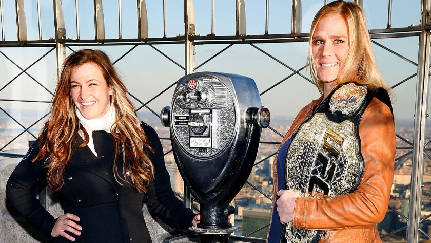 Miesha Tate, left, and Holly Holm visit the Empire State Building during a media event in New York on Jan. 21.