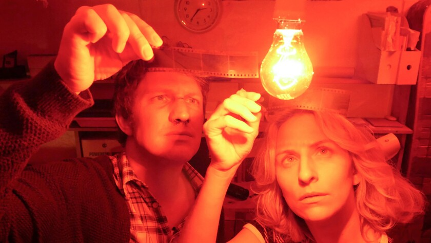 """(L-R) - Ruben Crow as Andrew and Mickey Sumner as Julie in a scene from """"Caught."""" Credit: Cinedigm"""